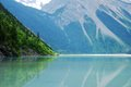 Kinney lake canadian rockies canada with turquoise blue water at the foot of mt robson and green leaves in spring june inscribed Stock Photo