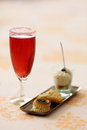 Kir royal coktail with amuse bouche details of a glass of and Royalty Free Stock Photography