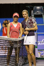 Kirilenko/zheng jie posing showdown of champions Stock Images