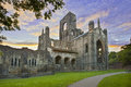 Kirkstall abbey at sunset leeds uk is a ruined cistercian monastery in north west of city centre in west yorkshire it is set in a Stock Images
