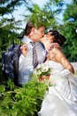 Kiss bride and groom Royalty Free Stock Photo