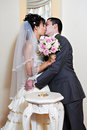 Kiss bride and groom Stock Images