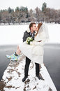 Kiss bride and groom on walk in winter walking wedding day Royalty Free Stock Photo
