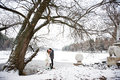 Kiss bride and groom in winter landscape on wedding day Royalty Free Stock Image