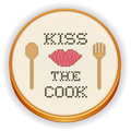 Kiss the cook cross stitch embroidery on wood hoop retro with needlework design with big red lips cooking fork and spoon isolated Stock Photo