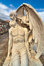 Kiss of death beautiful sculpture at the cemetery poblenou barcelona spain Stock Photo