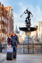 Kiss by the fountain of neptune gdansk poland two lovers in old town Royalty Free Stock Image