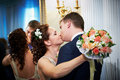 Kiss happy bride and groom Royalty Free Stock Photography