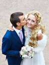 Kiss happy bride and groom at wedding walk Royalty Free Stock Photography