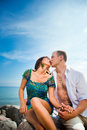 Kiss of loving couple near of blue sea Royalty Free Stock Photos
