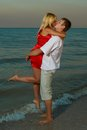 Kiss passionate male and women on the beach sea sunset Royalty Free Stock Images