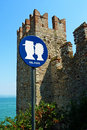 Kiss please a fun sign seen by a castle in italy lake garda in sirmione requesting couples to Stock Photography