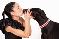 Kiss woman kissing doberman close up studio shot Royalty Free Stock Photos