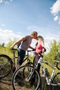 Kissing during biking Stock Images