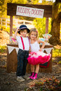 Kissing booth boy and girl in front of Stock Photography