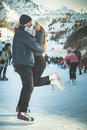 Kissing couple, girls and boy ice skating outdoor at rink Royalty Free Stock Photo
