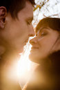 Kissing couple at sunshine weather closeup portrait of young Stock Photography