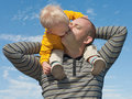 Kissing daddy in the skies Royalty Free Stock Photos