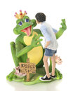 Kissing the frog a young teen girl a delighted prince price only five cents on a white background Royalty Free Stock Photography