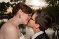 Kissing married gay couple two newlywed lesbians outside near pond Royalty Free Stock Photo
