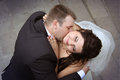 Kissing of newlyweds loving kiss passionately view downwards Stock Images