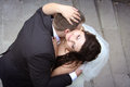 Kissing of newlyweds loving kiss passionately view downwards Royalty Free Stock Images
