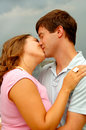 Kissing young couple Royalty Free Stock Image