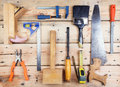 Kit of construction tools and instruments on wood texture background Royalty Free Stock Images