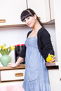 Kitchen activities portrait of a young woman in the Royalty Free Stock Photography