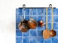 Kitchen appliances. Hanging retro design copper kitchenware set. Royalty Free Stock Photo