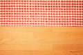 Kitchen background with checked tablecloth on wooden table. Royalty Free Stock Photo