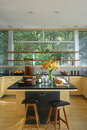 Kitchen With Black Worktop And Island Royalty Free Stock Photo
