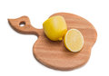 Kitchen chopping board with lemon cut in half wooden for form of apple Royalty Free Stock Photos