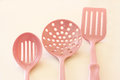 Kitchen cooking utensils plastic spatulas pink Stock Image