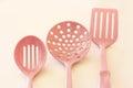 Kitchen cooking utensils plastic spatulas pink Stock Image
