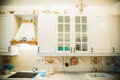 The kitchen is country-style white.interior design