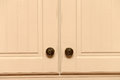 Kitchen cupboards a close up of cupboard doors and knobs Royalty Free Stock Photo