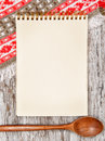 Kitchen cutting board and paper notebook on the old wood rustic background Royalty Free Stock Photos