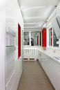 Kitchen domestic large modern interior with white cabinets Royalty Free Stock Photos