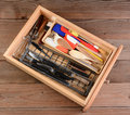 Kitchen drawer high angle view of a on a rustic wooden table the is full of wooden spoons knives whisks spatulas and other Royalty Free Stock Photos