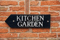 Kitchen garden sign fixed to a brick wall Stock Photos