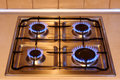Kitchen gas stove with flames of fire Royalty Free Stock Photography