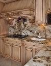 Kitchen granite range and hood design Royalty Free Stock Photo