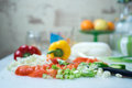 Kitchen interior cosy with fresh vegetables on table Stock Photography