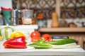 Kitchen interior cosy with fresh vegetables on table Royalty Free Stock Photo