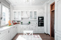 Kitchen interior in new luxury home with touch of retro. Modern Royalty Free Stock Photo