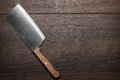 Kitchen knife on the brown wooden table Stock Images