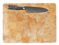 Kitchen knife laying on used chopping board Stock Photo