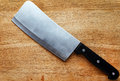 Kitchen knife on a wooden surface Stock Photo