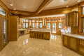 Kitchen made of wood in eco house large furniture and marble top and floor the windows the views the green Royalty Free Stock Photo